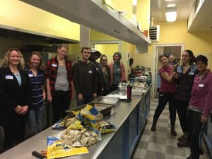 Undergraduate and graduate students prepare the meal for PACEM guests, winter 2016.